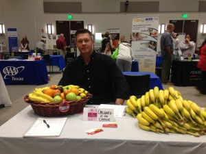 Kevin Long, our Chief Banana, sets up the display for our Collin College offerings (very different from our Dallas Business Journal presentation!).