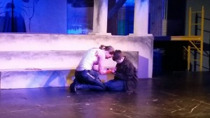 Brutus (Rachel Svatos) and Lucius (Calin) mourn plans gone awry and moments drawing to a close at the end of Julius Caesar.
