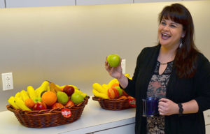 Happy employee with fresh fruit