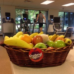 Fresh fruit displayed by a set of exercise equipment